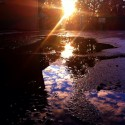 Skyscape in the puddle